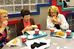 Miffie Levin, Marilyn Tempkins, and Susan Pritikin enjoy Chicago style hotdogs at Michael's.