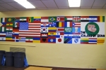 A mural depicting the flags of the countries of origin of current students.
