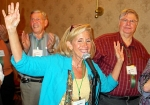 Reunion committee coordinator Jackie Stern waves as she welcomes the assembled classmates on Friday night.  Larry Wolfso